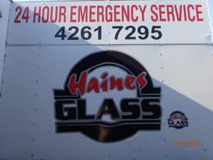 Signage on the side of the Haines Glass ute