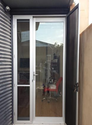A small glass door installed for the entry of a house in Wollongong