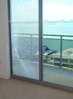 A smashed glass door to an apartment balcony in Illawarra