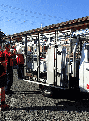 A Haines Glass worker loading his ute outside the workshop in Dapto